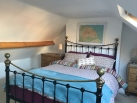 king bedroom in Holiday Cottage